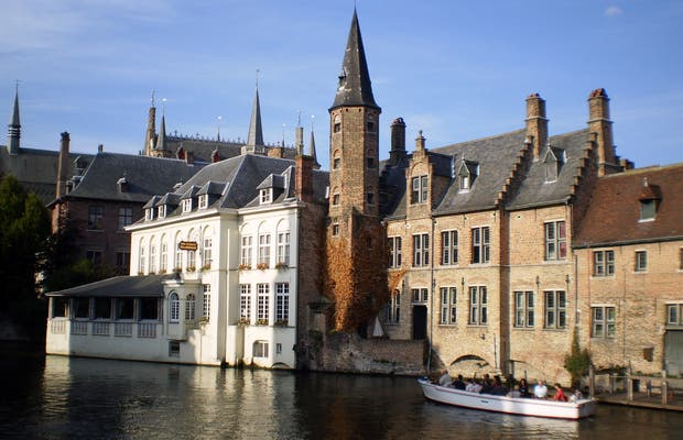 Boat trip by Bruges canals